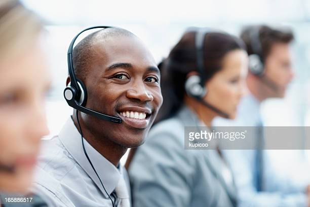 Call center employees wearing headsets in a row