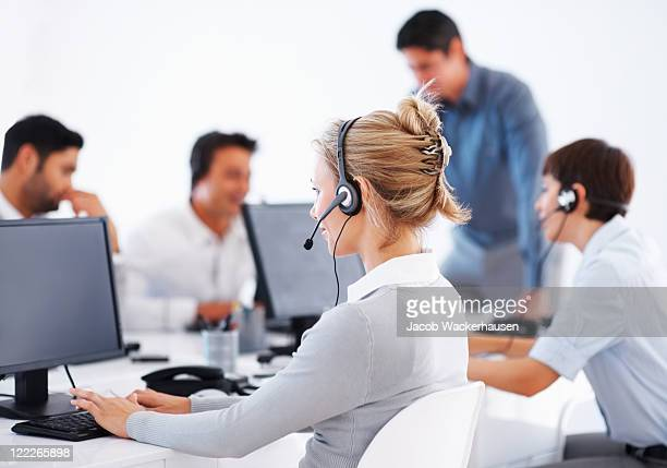 Call center employees with headset