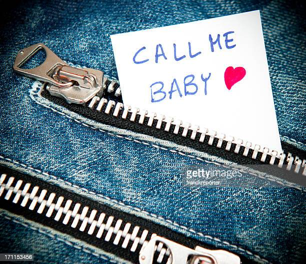Call me Baby written in a zip pocket of jeans