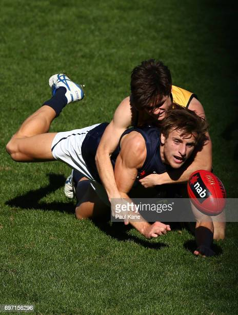 Callan England of Western Australia tackles Callum Searle of Vic Metro during the U18 Championships match between Western Australia and Victoria...