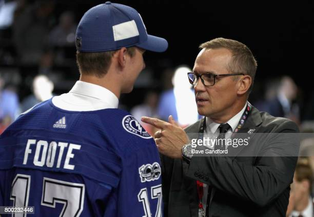 Callan Foote 14th overall of the Tampa Bay Lightning meets general manager Steve Yzerman during Round One of the 2017 NHL Draft at United Center on...
