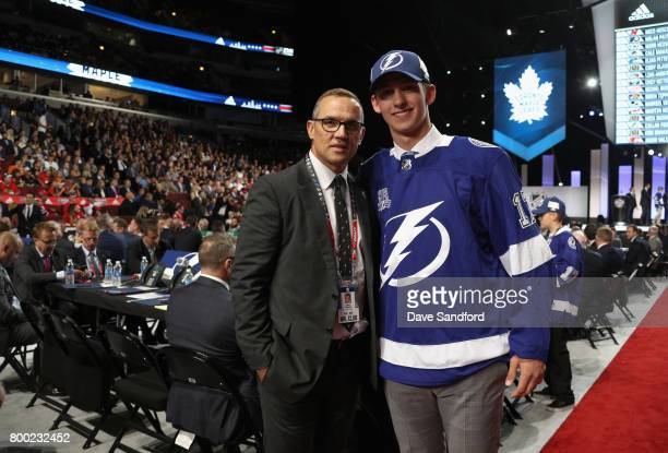 Callan Foote 14th overall of the Tampa Bay Lightning poses with general manager Steve Yzerman during Round One of the 2017 NHL Draft at United Center...