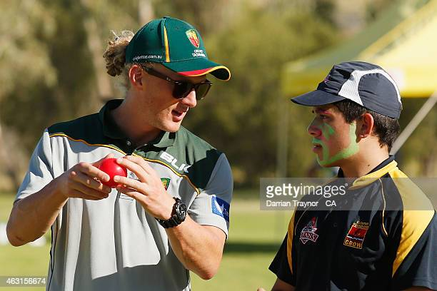 Callan Morse of Tasmania gives instructions to a young cricketer during a school clinic at Yirara College in ALice Springs during the 20415 Imparja...