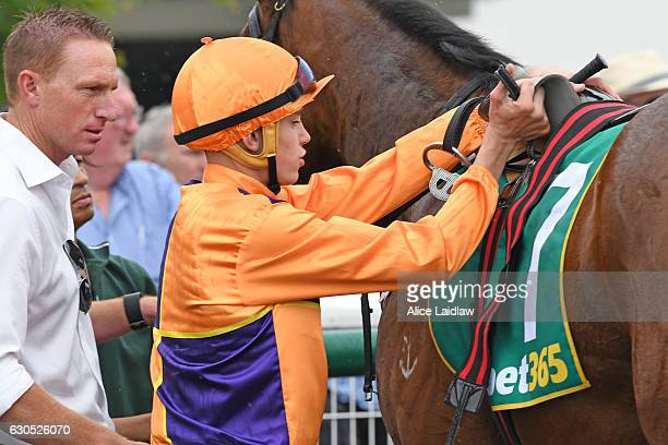 Callan Murray returns to the mounting yard after winning Faullâs Shoes TwoYearsOld Maiden Plate at Geelong Racecourse on December 26 2016 in Geelong...