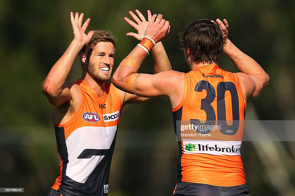 Callan Ward and Lachlan Plowman of the Giants celebrate after victory over the Saints during the AFL practice match between the Greater Western Sydney Giants and the St Kilda Saints at Blacktown International Sportspark on March 16, 2013 in Sydney, Australia.