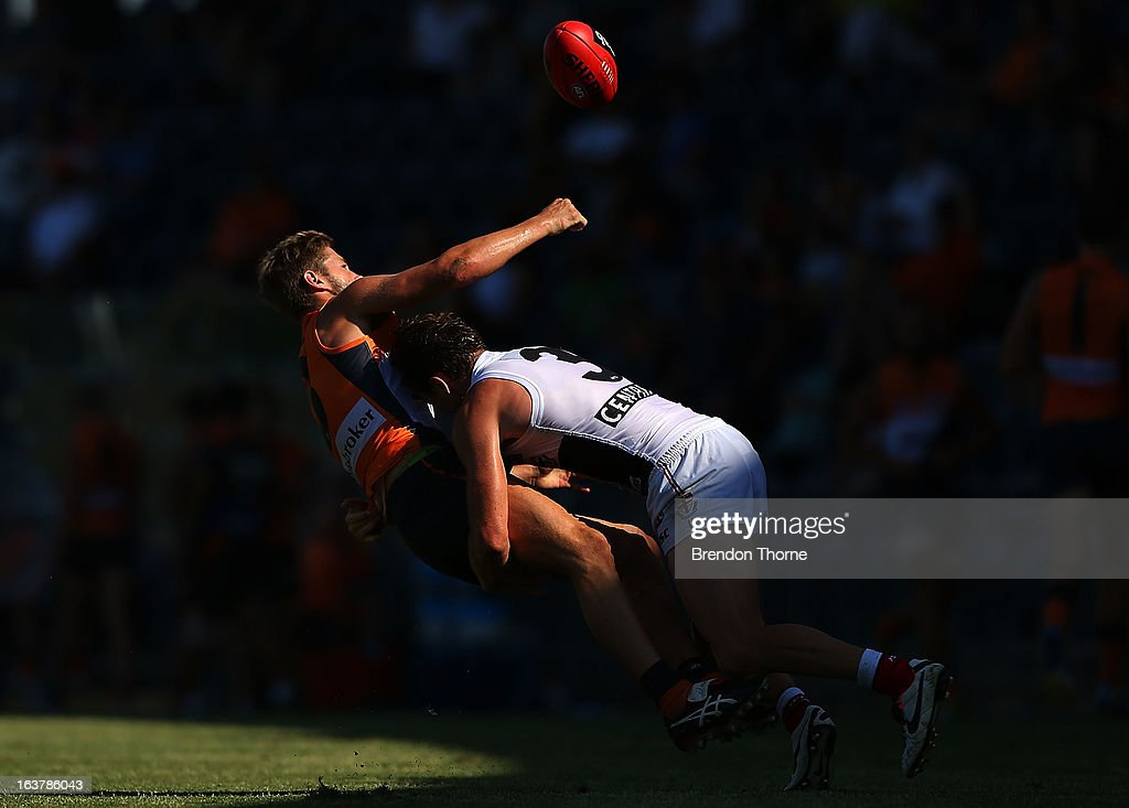 Callan Ward of the Giants competes with Jack Steven of the Saints during the AFL practice match between the Greater Western Sydney Giants and the St Kilda Saints at Blacktown International Sportspark on March 16, 2013 in Sydney, Australia.