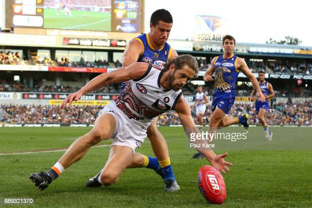 Callan Ward of the Giants contests for the ball against Liam Duggan of the Eagles during the round 10 AFL match between the West Coast Eagles and the...