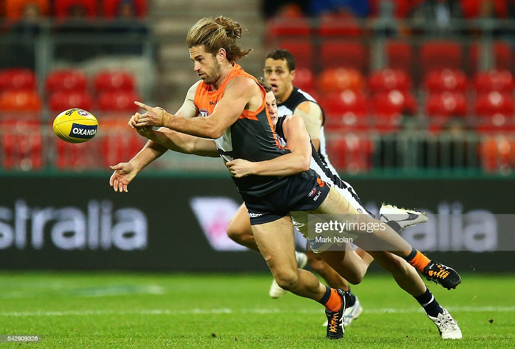 Callan Ward of the Giants hand balls during the round 14 AFL match between the Greater Western Sydney Giants and the Carlton Blues at Spotless Stadium on June 25, 2016 in Sydney, Australia.