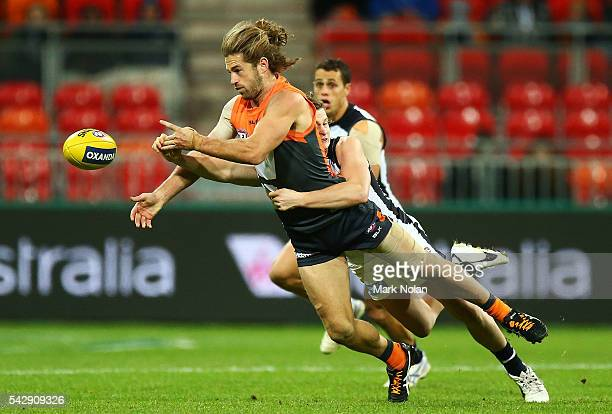 Callan Ward of the Giants hand balls during the round 14 AFL match between the Greater Western Sydney Giants and the Carlton Blues at Spotless...