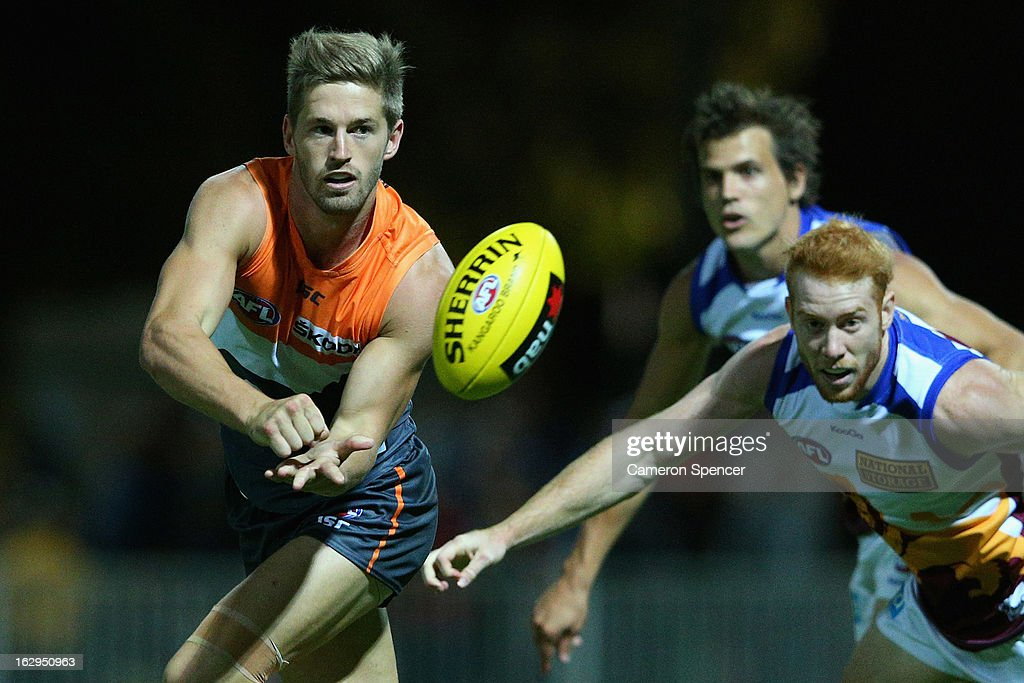 Callan Ward of the Giants hand passes during the round two AFL NAB Cup match between the Greater Western Sydney Giants and the Brisbane Lions at the Robertson Oval in Wagga Wagga, Australia.