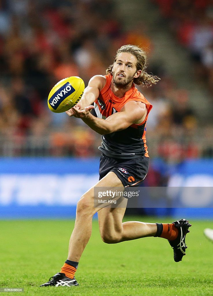 Callan Ward of the Giants handballs during the round six AFL match between the Greater Western Sydney Giants and the Hawthorn Hawks at Spotless Stadium on April 30, 2016 in Sydney, Australia.