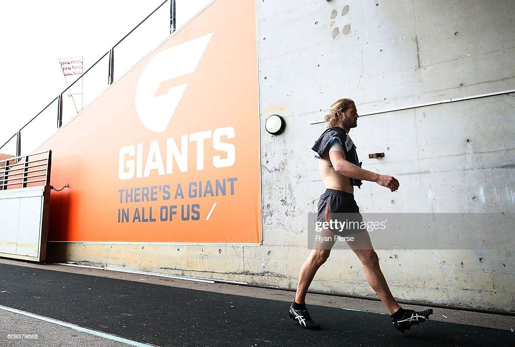 Callan Ward of the Giants leaves the ground during GWS Giants media and training session on September 21, 2016 in Sydney, Australia.