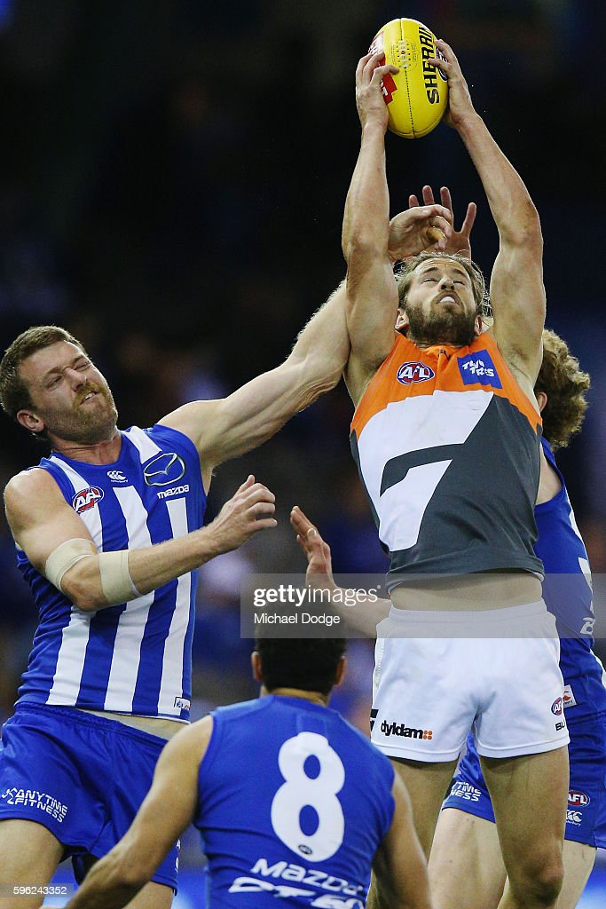 Callan Ward of the Giants marks the ball against Lachlan Hansen of the Kangaroos during the round 23 AFL match between the North Melbourne Kangaroos...