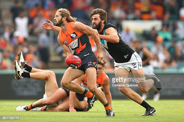 Callan Ward of the Giants offloads the ball during the round four AFL match between the Greater Western Sydney Giants and the Port Adelaide Power at...