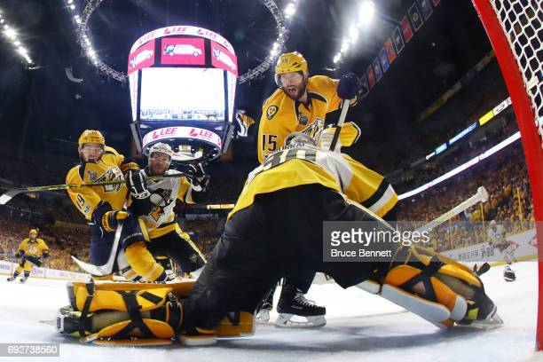 Calle Jarnkrok and Craig Smith of the Nashville Predators crash the net as Matt Murray and Carter Rowney of the Pittsburgh Penguins defend in Game...