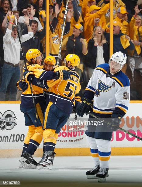 Calle Jarnkrok celebrates his empty net goal with Filip Forsberg and Austin Watson of the Nashville Predators against Vladimir Tarasenko of the St...
