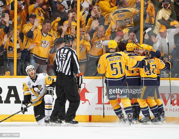 Calle Jarnkrok celebrates his goal with Austin Watson Craig Smith Matt Irwin of the Nashville Predators against Carter Rowney of the Pittsburgh...