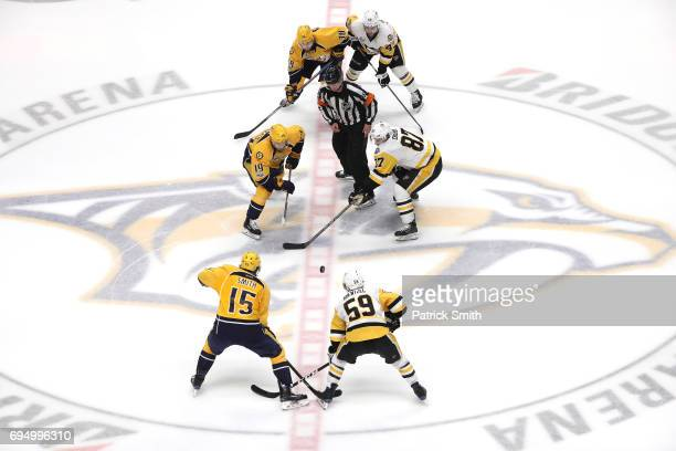 Calle Jarnkrok of the Nashville Predators and Sidney Crosby of the Pittsburgh Penguins face off to open the third period in Game Six of the 2017 NHL...