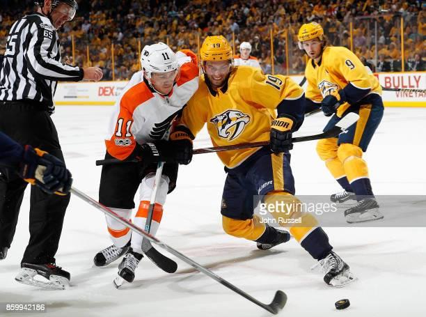 Calle Jarnkrok of the Nashville Predators battles in a faceoff against Travis Konecny of the Philadelphia Flyers during an NHL game at Bridgestone...