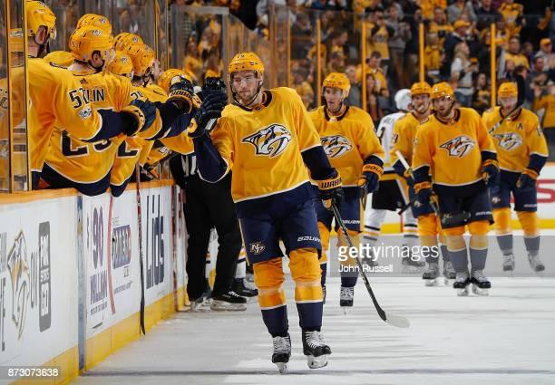 Calle Jarnkrok of the Nashville Predators celebrates his goal along the bench against the Pittsburgh Penguins during an NHL game at Bridgestone Arena...