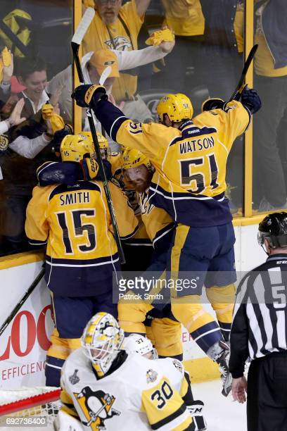 Calle Jarnkrok of the Nashville Predators celebrates with his teammates after scoring a goal against Matt Murray of the Pittsburgh Penguins during...