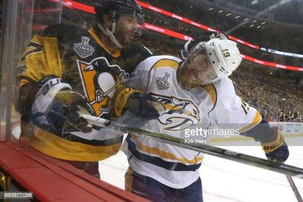 Calle Jarnkrok of the Nashville Predators collides with Matt Cullen of the Pittsburgh Penguins in the second period in Game Five of the 2017 NHL...