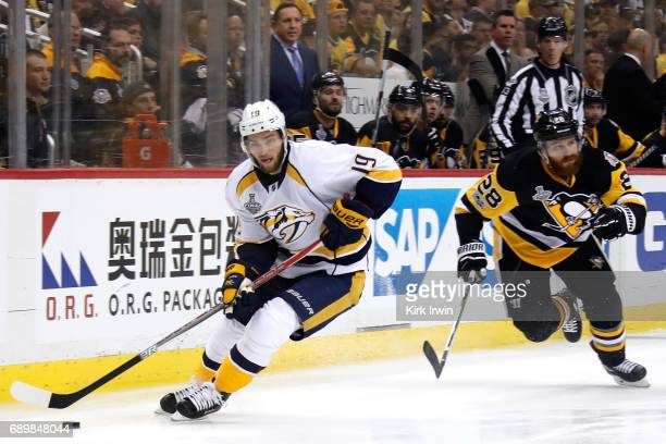 Calle Jarnkrok of the Nashville Predators controls the puck against Ian Cole of the Pittsburgh Penguins during the first period in Game One of the...