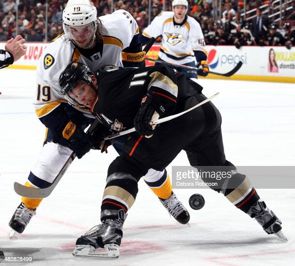 Calle Jarnkrok of the Nashville Predators faces off with Saku Koivu of the Anaheim Ducks on April 4 2014 at Honda Center in Anaheim California