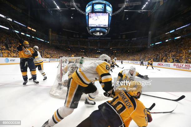 Calle Jarnkrok of the Nashville Predators falls to the ice against Sidney Crosby and Olli Maatta of the Pittsburgh Penguins during the second period...