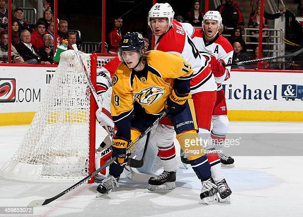 Calle Jarnkrok of the Nashville Predators gets in position near the crease against Victor Rask Cam Ward and Ron Hainsey during their NHL game at PNC...