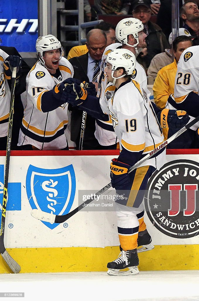 Calle Jarnkrok #19 of the Nashville Predators is congratulated by Craig Smith #15 after scoring a third period goal against the Chicago Blackhawks at the United Center on February 25, 2016 in Chicago, Illinois. The Predators defeated the Blackhawks 3-1.