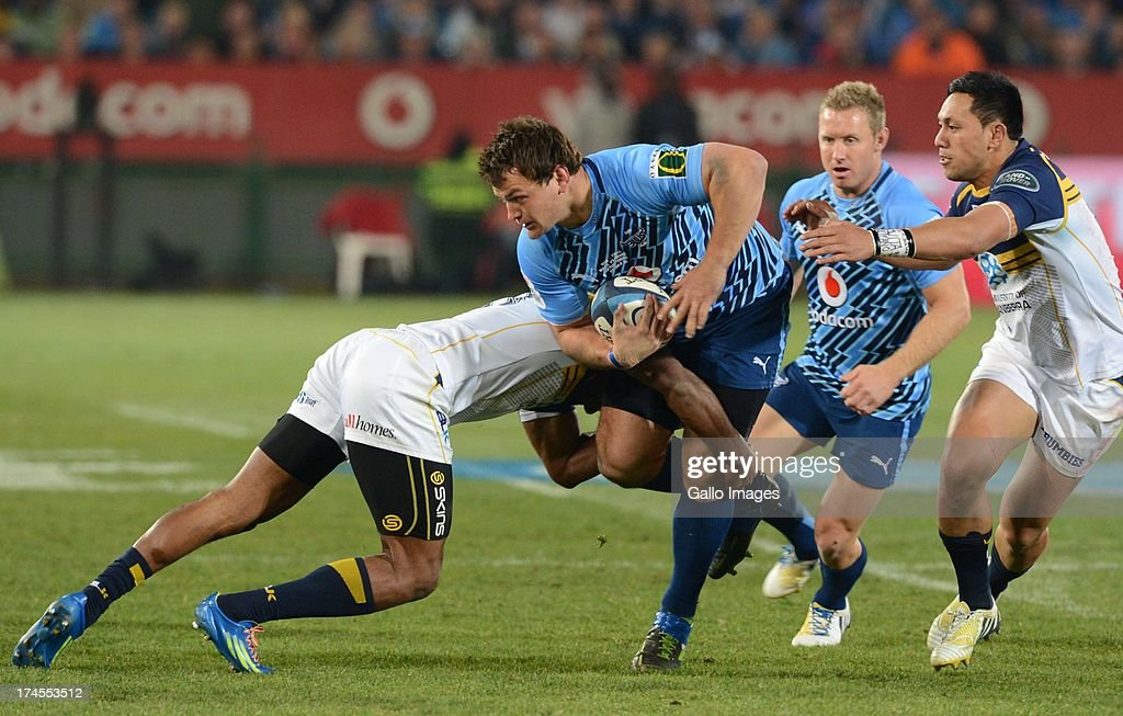 Callie Visagie of the Bulls is tackled during the SupeRugby semi final match between Vodacom Bulls and Brumbies at Loftus Versfeld Stadium on July 27, 2013 in Pretoria, South Africa.