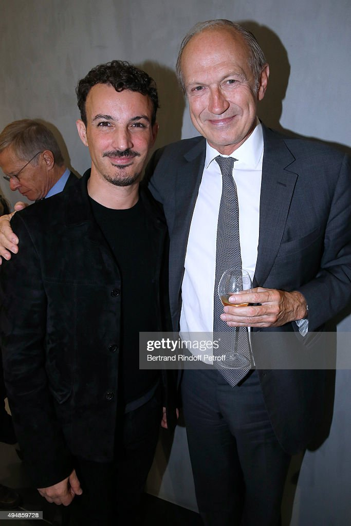 Calligrapher Nicolas Ouchenir and President of l'Oreal <a gi-track='captionPersonalityLinkClicked' href=/galleries/search?phrase=Jean-Paul+Agon&family=editorial&specificpeople=675160 ng-click='$event.stopPropagation()'>Jean-Paul Agon</a> attend the Opening of the Collection 'Exemplaire x Nicolas Ouchenir' at Exemplaire Store on October 29, 2015 in Paris, France.