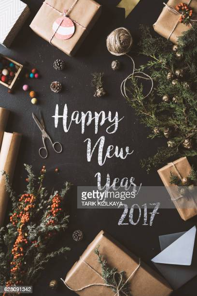 Calligraphy Happy New Year chalk written blackboard, flat lay