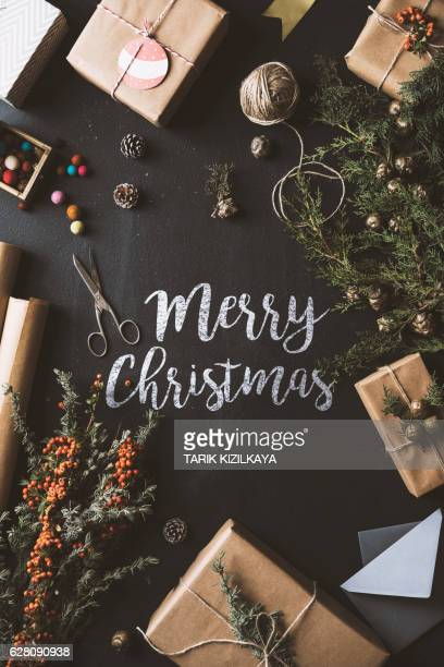 Calligraphy Merry Christmas chalk written blackboard, flat lay