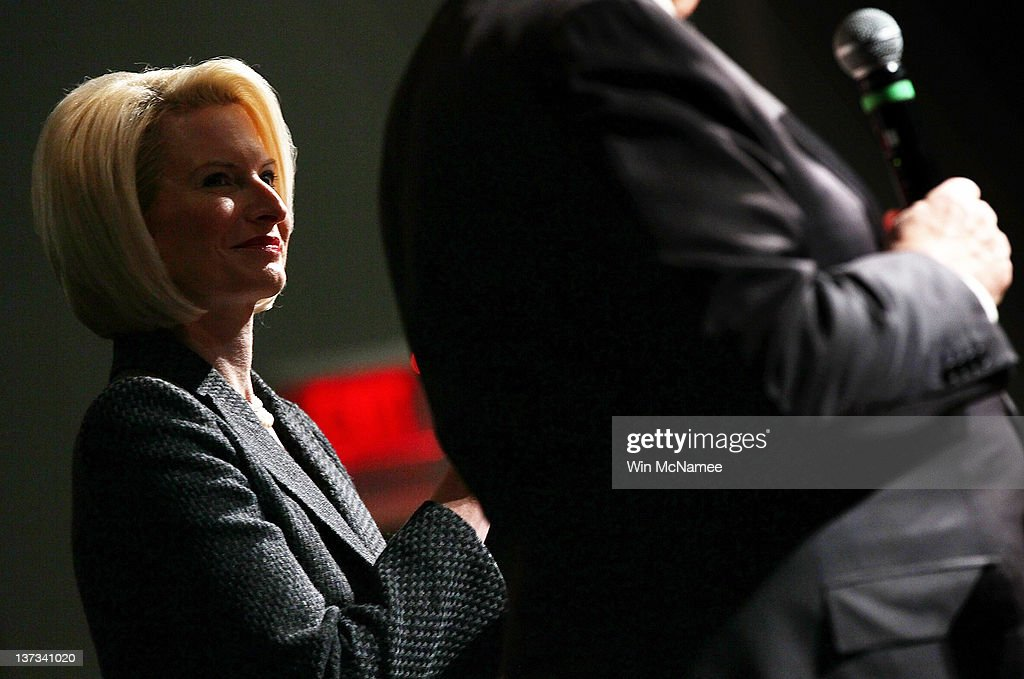 Callista Gingrich, wife of Republican presidential candidate, former Speaker of the House Newt Gingrich, listens as her husband answers questions during a Town Hall meeting at Sun City's Magnolia Hall January 19, 2012 in Bluffton, South Carolina. Texas Gov. Rick Perry is expected to announce this morning that he is withdrawing from the race for the Republican nomination prior to the South Carolina primary and support Gingrich.