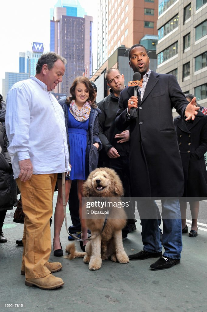 AJ Calloway (R) and Charles the Monarch (C) visit 'Extra' in Times Square on January 10, 2013 in New York City.