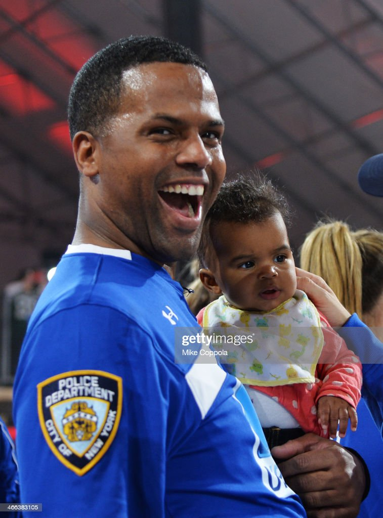 Calloway and daughter Amy Belle Calloway participate in the DirecTV Beach Bowl at Pier 40 on February 1 2014 in New York City