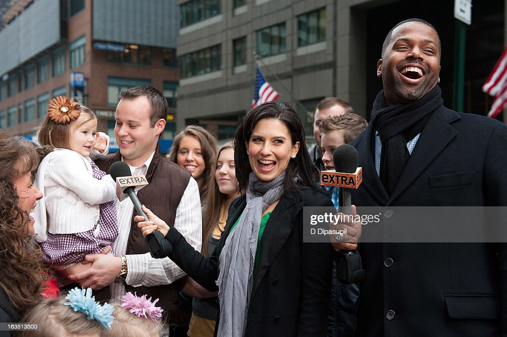 AJ Calloway and Hilaria Baldwin interview Josh Duggar and his daughter during their visit with 'Extra' in Times Square on March 11, 2013 in New York City.