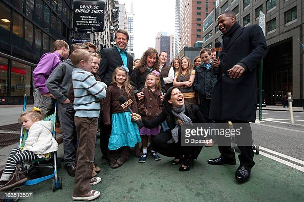 AJ Calloway and Hilaria Baldwin interview the Duggar family during their visit with 'Extra' in Times Square on March 11 2013 in New York City