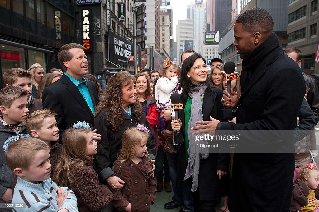 AJ Calloway and <a gi-track='captionPersonalityLinkClicked' href=/galleries/search?phrase=Hilaria+Baldwin&family=editorial&specificpeople=7856471 ng-click='$event.stopPropagation()'>Hilaria Baldwin</a> interview the Duggar family during their visit with 'Extra' in Times Square on March 11, 2013 in New York City.