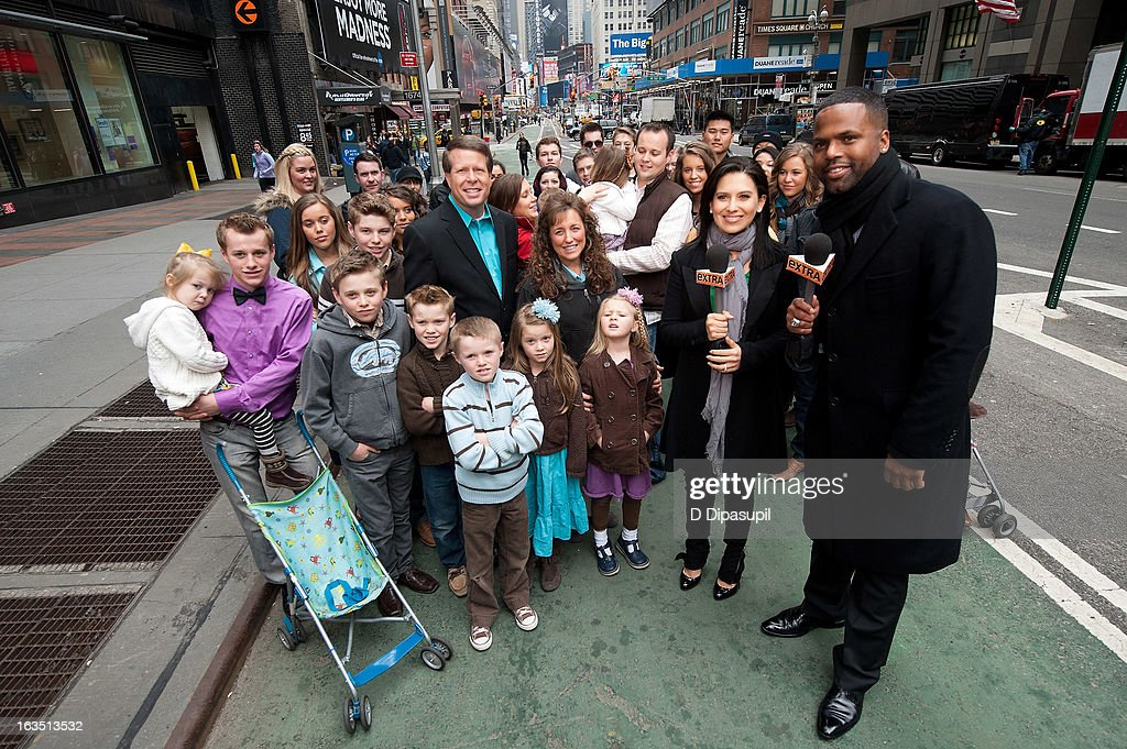 AJ Calloway and <a gi-track='captionPersonalityLinkClicked' href=/galleries/search?phrase=Hilaria+Baldwin&family=editorial&specificpeople=7856471 ng-click='$event.stopPropagation()'>Hilaria Baldwin</a> pose with the Duggar family during their visit with 'Extra' in Times Square on March 11, 2013 in New York City.