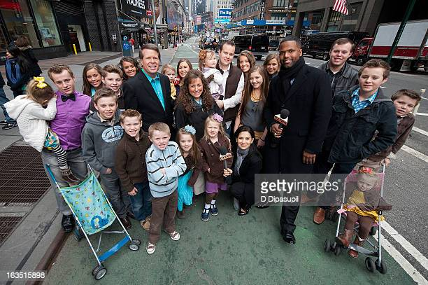 Calloway and Hilaria Baldwin pose with the Duggar family during their visit with 'Extra' in Times Square on March 11 2013 in New York City