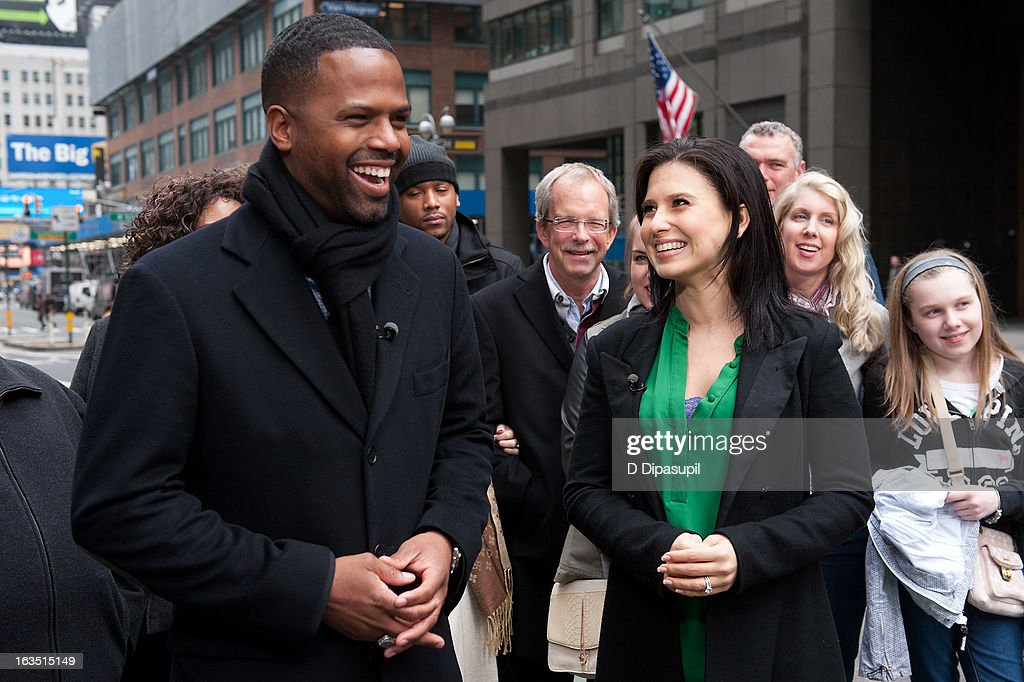 AJ Calloway (L) and <a gi-track='captionPersonalityLinkClicked' href=/galleries/search?phrase=Hilaria+Baldwin&family=editorial&specificpeople=7856471 ng-click='$event.stopPropagation()'>Hilaria Baldwin</a> visit 'Extra' in Times Square on March 11, 2013 in New York City.