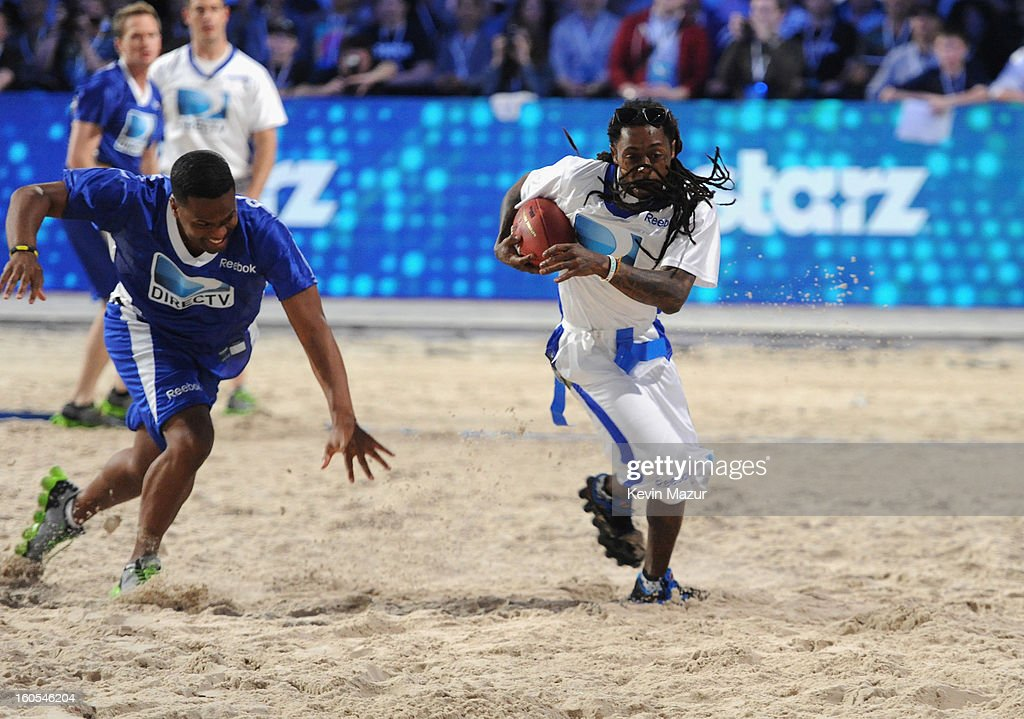 AJ Calloway and Lil Wayne attend DIRECTV'S 7th annual celebrity Beach Bowl at DTV SuperFan Stadium at Mardi Gras World on February 2, 2013 in New Orleans, Louisiana.