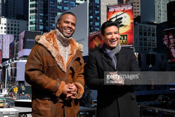 Calloway and Mario Lopez on the set of 'Extra' at their New York studios at the Hard Rock Cafe in Times Square on March 16 2017 in New York City
