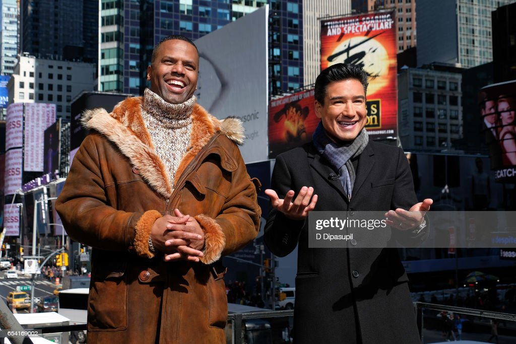 AJ Calloway (L) and Mario Lopez on the set of 'Extra' at their New York studios at the Hard Rock Cafe in Times Square on March 16, 2017 in New York City.