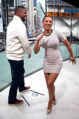 Calloway and Mel B dance on the set during her visit to 'Extra' at their New York studios at HM in Times Square on March 31 2015 in New York City