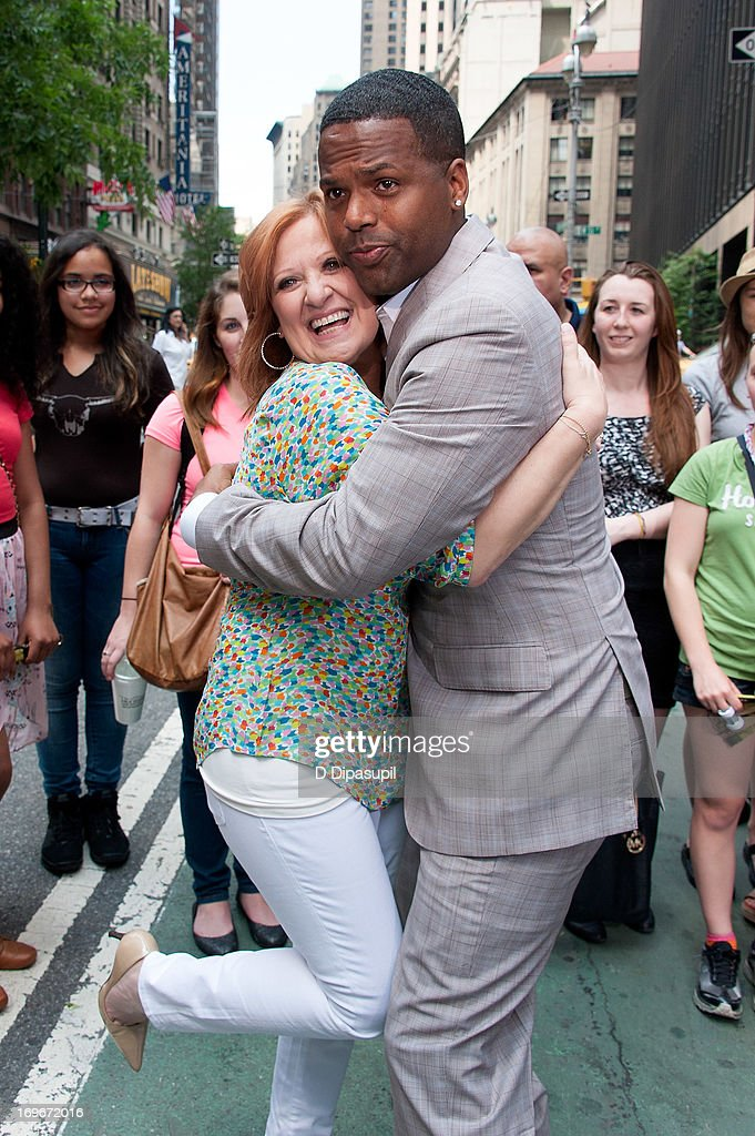 AJ Calloway (R) hugs <a gi-track='captionPersonalityLinkClicked' href=/galleries/search?phrase=Caroline+Manzo&family=editorial&specificpeople=5841102 ng-click='$event.stopPropagation()'>Caroline Manzo</a> of 'Real Housewives of New Jersey' during her visit to 'Extra' in Times Square on May 30, 2013 in New York City.