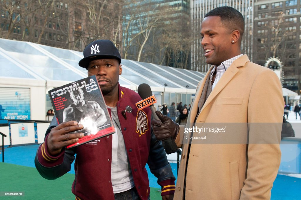 AJ Calloway (R) interviews 50 Cent during his visit to 'Extra' at Bryant Park on January 18, 2013 in New York City.